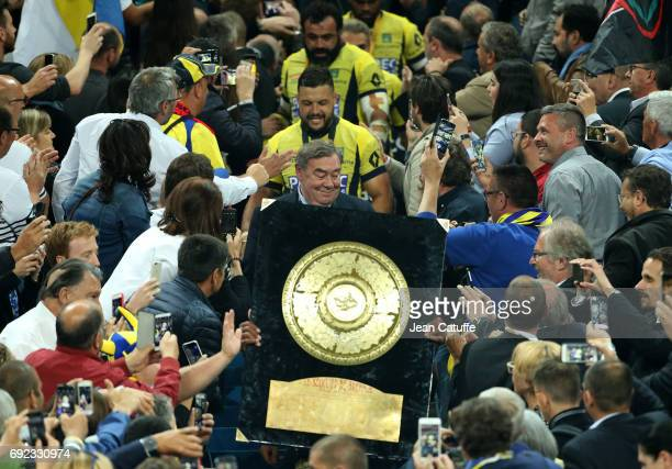 President of ASM Clermont Eric de Cromieres Damien Chouly celebrate the victory during the Bouclier de Brennus trophy presentation following the Top...