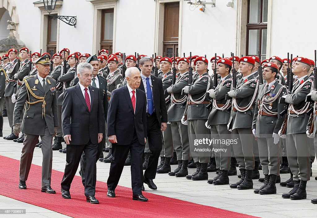 President of Austria Heinz Fischer (L) and Israel President Shimon Peres (R) review the honor guard during a welcoming ceremony at Hofburg palace in Vienna, Austria on March 31, 2014.