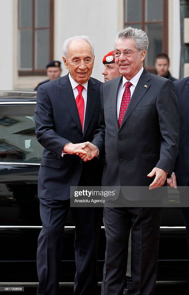 President of Austria Heinz Fischer (R) welcomes Israel President <a gi-track='captionPersonalityLinkClicked' href=/galleries/search?phrase=Shimon+Peres&family=editorial&specificpeople=201775 ng-click='$event.stopPropagation()'>Shimon Peres</a> (L) during a welcoming ceremony at Hofburg palace in Vienna, Austria on March 31, 2014.