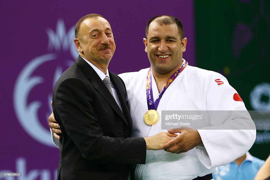 President of Azerbaijan <a gi-track='captionPersonalityLinkClicked' href=/galleries/search?phrase=Ilham+Aliyev&family=editorial&specificpeople=565601 ng-click='$event.stopPropagation()'>Ilham Aliyev</a> congratulates Gold medalist Ilham Zakiyev of Azerbaijan after presenting the medal won in the Men's Visually Impaired finals during day fourteen of the Baku 2015 European Games at the Heydar Aliyev Arena on June 26, 2015 in Baku, Azerbaijan.