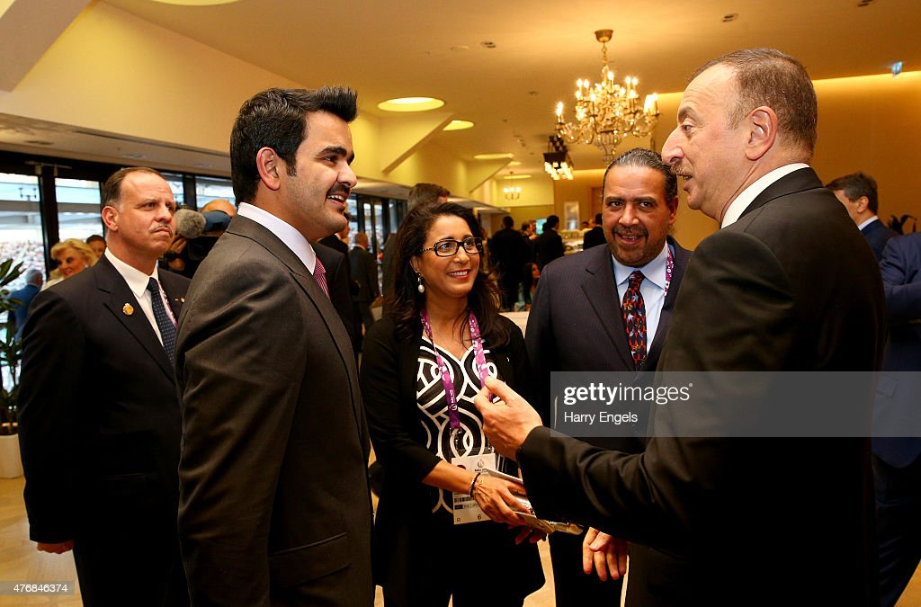 President of Azerbaijan Ilham Aliyev (R) greets Sheikh Joaan bin Hamad Al Thani President of the Qatar Olympic Committee (QOC), <a gi-track='captionPersonalityLinkClicked' href=/galleries/search?phrase=Nawal+El+Moutawakel&family=editorial&specificpeople=215203 ng-click='$event.stopPropagation()'>Nawal El Moutawakel</a>, IOC Member & OCA President HE Sheikh Ahmad Al-Fahad Al-Sabah during the Opening Ceremony for the Baku 2015 European Games at the Olympic Stadium on June 12, 2015 in Baku, Azerbaijan.