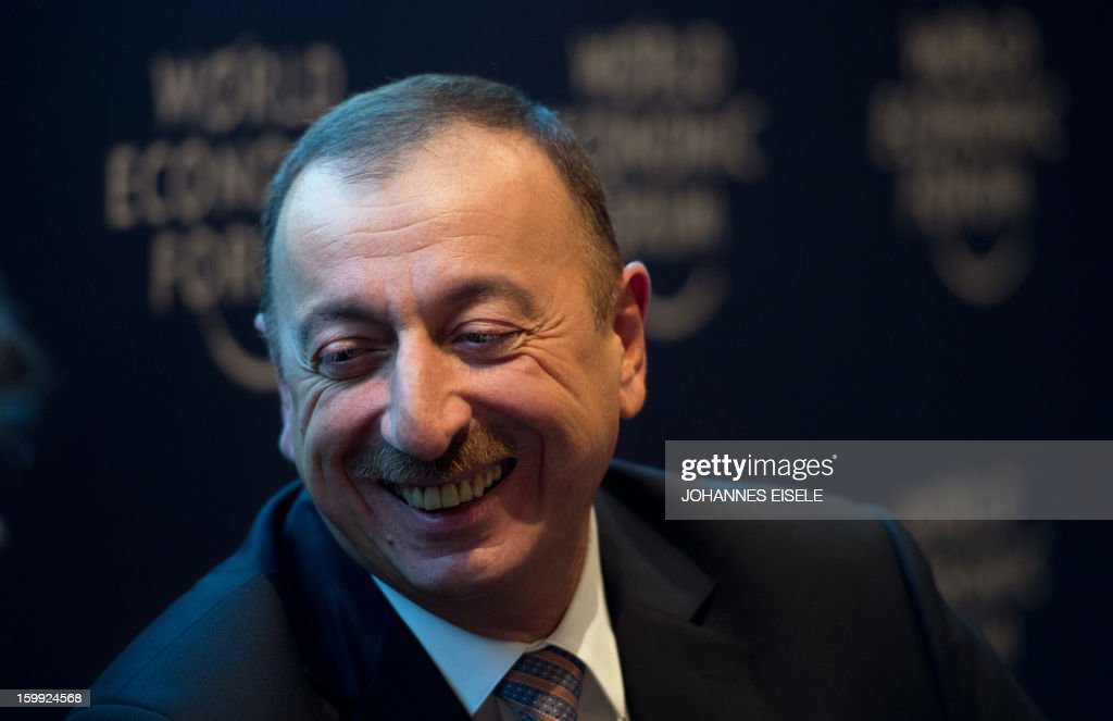 President of Azerbaijan Ilham Aliyev laughs during a discussion panel at the World Economic Forum 2013 annual meeting in the Swiss resort town of Davos, on January 23, 2013. The World Economic Forum (WEF) is taking place from January 23 to 27.