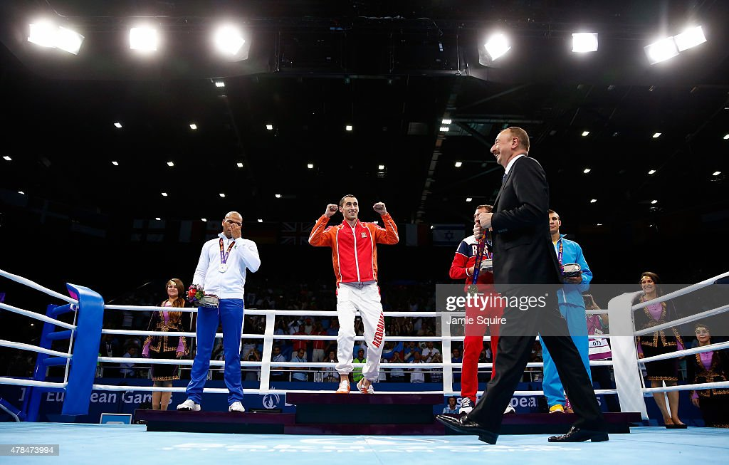 President of Azerbaijan <a gi-track='captionPersonalityLinkClicked' href=/galleries/search?phrase=Ilham+Aliyev&family=editorial&specificpeople=565601 ng-click='$event.stopPropagation()'>Ilham Aliyev</a> present medals to silver medalist <a gi-track='captionPersonalityLinkClicked' href=/galleries/search?phrase=Valentino+Manfredonia&family=editorial&specificpeople=14707657 ng-click='$event.stopPropagation()'>Valentino Manfredonia</a> of Italy, gold medalist <a gi-track='captionPersonalityLinkClicked' href=/galleries/search?phrase=Teymur+Mammadov&family=editorial&specificpeople=9582590 ng-click='$event.stopPropagation()'>Teymur Mammadov</a> of Azerbaijan and bronze medalists <a gi-track='captionPersonalityLinkClicked' href=/galleries/search?phrase=Pavel+Silyagin&family=editorial&specificpeople=14322118 ng-click='$event.stopPropagation()'>Pavel Silyagin</a> of Russia and Oleksandr Khyzhniak of Ukraine stand on the podium during the medal ceremony for the Men's Light Heavyweight 81kg final during day thirteen of the Baku 2015 European Games at the Crystal Hall on June 25, 2015 in Baku, Azerbaijan.