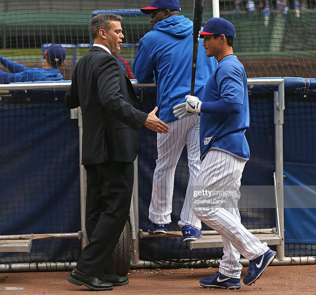 President of Baseball Operations Theo Epstein of the Chicago Cubs (L) shakes hands with Darwin Barney during batting practice before the Opening Day game between the Cubs and the Milwaukee Brewers at Wrigley Field on April 8, 2013 in Chicago, Illinois.