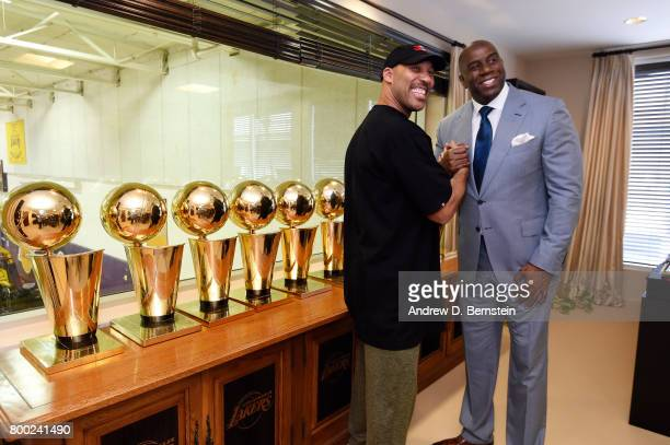 President of Basketball Operation of the Los Angeles Lakers Magic Johnson poses for a picture with LaVar Ball following a press conference to...