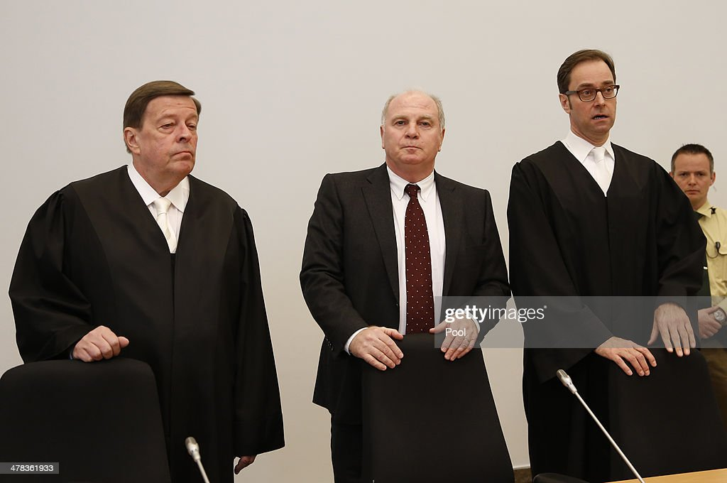 President of Bayern Muenchen Ulrich Hoeness (C) and his lawyers Markus Gotzens (R) and Hanns W. Feigen (L) stand in the courtroom during Hoeness' trial for tax evasion at the Higher Regional Court of Munich on March 13, 2014 in Munich, Germany. Hoeness is accused of tax evasion by siphoning more than 33million Euros into a Swiss bank account.
