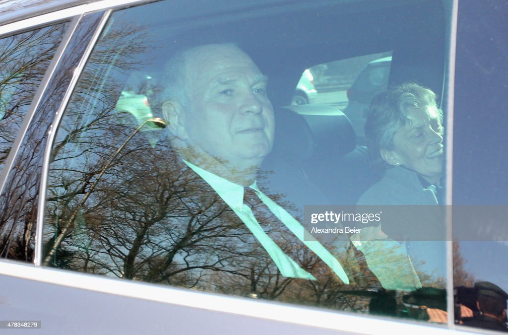 President of Bayern Muenchen Ulrich Hoeness (L) and his wife Susanne arrive for the verdict day of Hoeness' trial at the Higher Regional Court on March 13, 2014 in Munich, Germany. Hoeness is accused of tax evasion by siphoning more than 27.2 million Euros into a Swiss bank account.