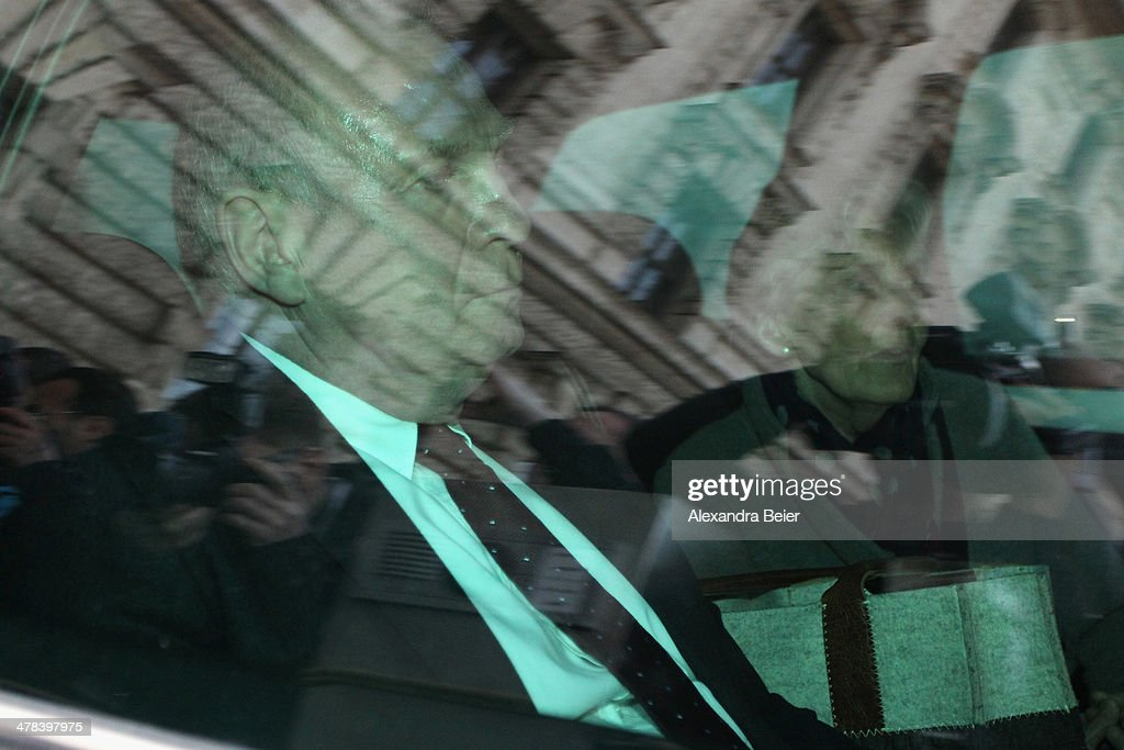President of Bayern Muenchen Ulrich Hoeness (L) and his wife Susanne leave the Higher Regional Court after hisverdict on March 13, 2014 in Munich, Germany. Hoeness is sentenced to three and a half years in prison for tax evasion by siphoning more than 27.2 million Euros into a Swiss bank account.