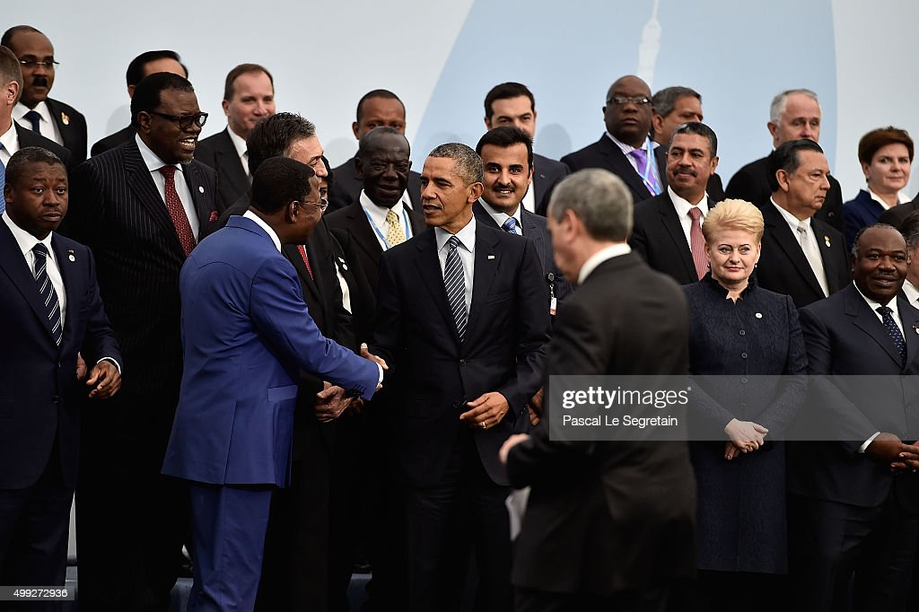 President of Benin,Thomas Boni Yayi shakes hands with U.S President Barak Obama before the Family photo of the COP 21 on November 30, 2015 in Le Bourget, France.