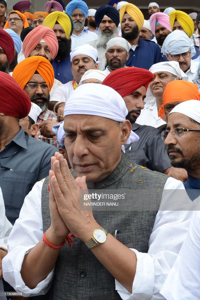 President of Bharatiya Janata Party (BJP), Rajnath Singh pays his respects at the Sikh Shrine Golden temple in Amritsar on July 7, 2013. Rajnath Singh visited the city to attend a two-day meeting with the executive body of the Punjab state BJP at a resort on the outskirts of Amritsar and paid his respects at the Sikh Shrine, Jallianwala Bagh and Durgiana temple. AFP PHOTO/NARINDER NANU
