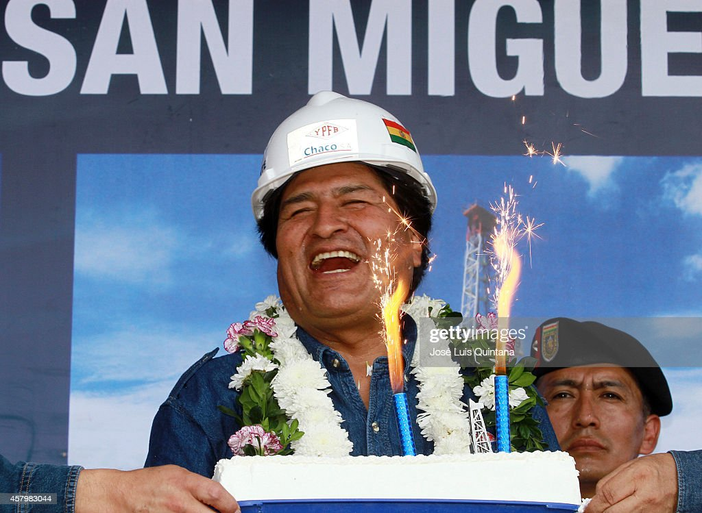 President of Bolivia <a gi-track='captionPersonalityLinkClicked' href=/galleries/search?phrase=Evo+Morales&family=editorial&specificpeople=272981 ng-click='$event.stopPropagation()'>Evo Morales</a> laughs during the celebration of his 55th birthday during a tour of inspection at San Miguel-X1 well on October 26, 2014 in Cochabamba, Bolivia.