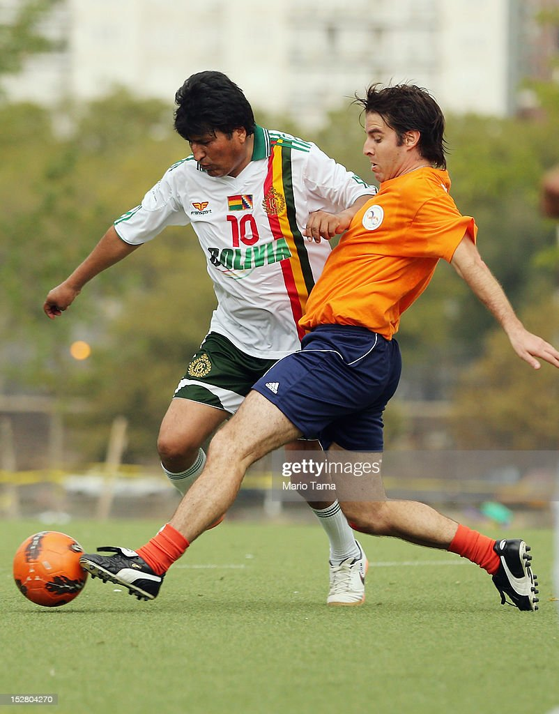 President of Bolivia <a gi-track='captionPersonalityLinkClicked' href=/galleries/search?phrase=Evo+Morales&family=editorial&specificpeople=272981 ng-click='$event.stopPropagation()'>Evo Morales</a> (L) plays in a friendly soccer match against U.N. officials during the 67th session of the United Nations General Assembly at Roosevelt Island Soccer Field on September 26, 2012 in New York City. The game was intended to raise awareness of the U.N.'s UNiTE to End Violence against Women campaign.