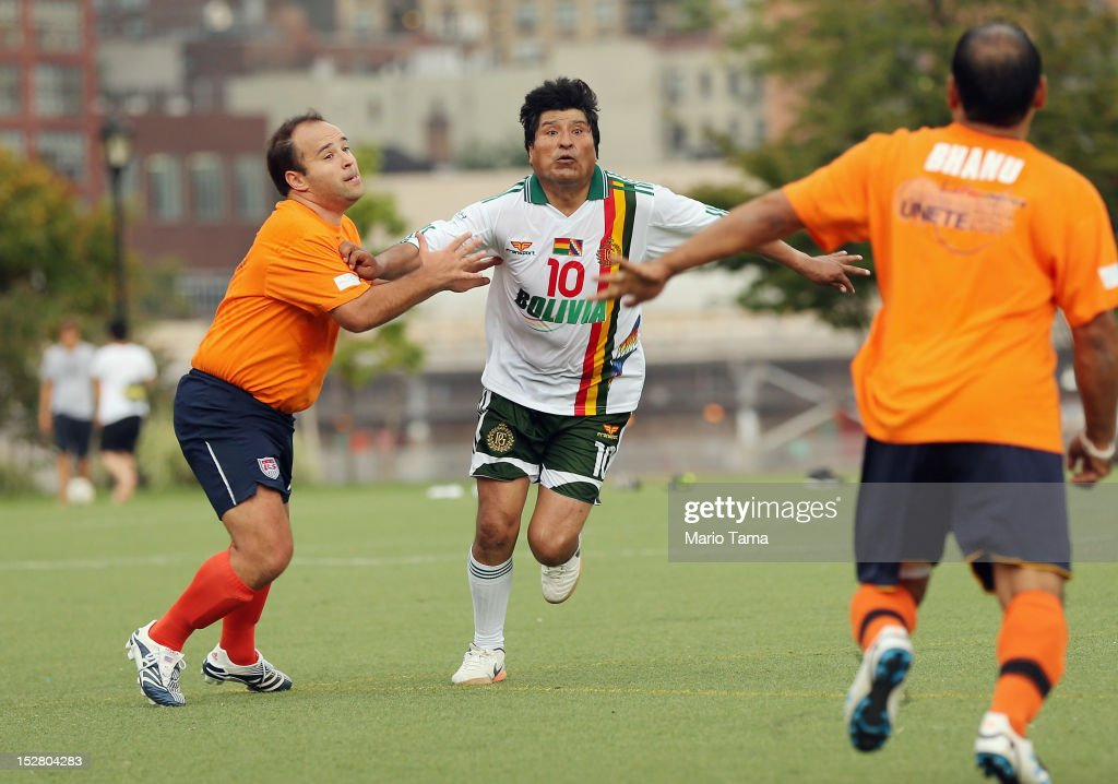 President of Bolivia <a gi-track='captionPersonalityLinkClicked' href=/galleries/search?phrase=Evo+Morales&family=editorial&specificpeople=272981 ng-click='$event.stopPropagation()'>Evo Morales</a> (C) plays in a friendly soccer match against U.N. officials during the 67th session of the United Nations General Assembly at Roosevelt Island Soccer Field on September 26, 2012 in New York City. The game was intended to raise awareness of the U.N.'s UNiTE to End Violence against Women campaign.