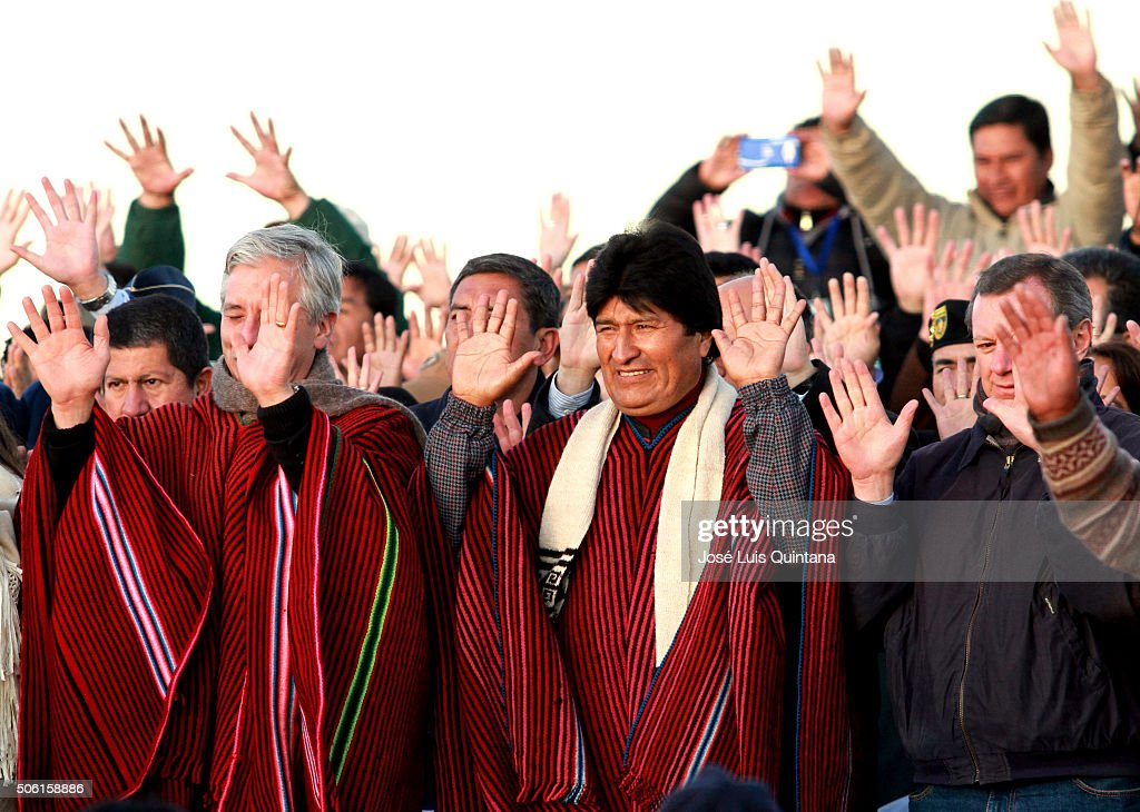 President of Bolivia <a gi-track='captionPersonalityLinkClicked' href=/galleries/search?phrase=Evo+Morales&family=editorial&specificpeople=272981 ng-click='$event.stopPropagation()'>Evo Morales</a> (C), Vicepresident Alvaro Garcia (L) and <a gi-track='captionPersonalityLinkClicked' href=/galleries/search?phrase=Alberto+Gonzales&family=editorial&specificpeople=206183 ng-click='$event.stopPropagation()'>Alberto Gonzales</a>, President of the Senate raise thier hands during the celebration of the 10th anniversary of <a gi-track='captionPersonalityLinkClicked' href=/galleries/search?phrase=Evo+Morales&family=editorial&specificpeople=272981 ng-click='$event.stopPropagation()'>Evo Morales</a>' government on January 21, 2016. Morales and members of his cabinet and government gave an offering to the 'Pachamama' (Mother earth) as part of the celebration of his 10th year as Bolivia President.