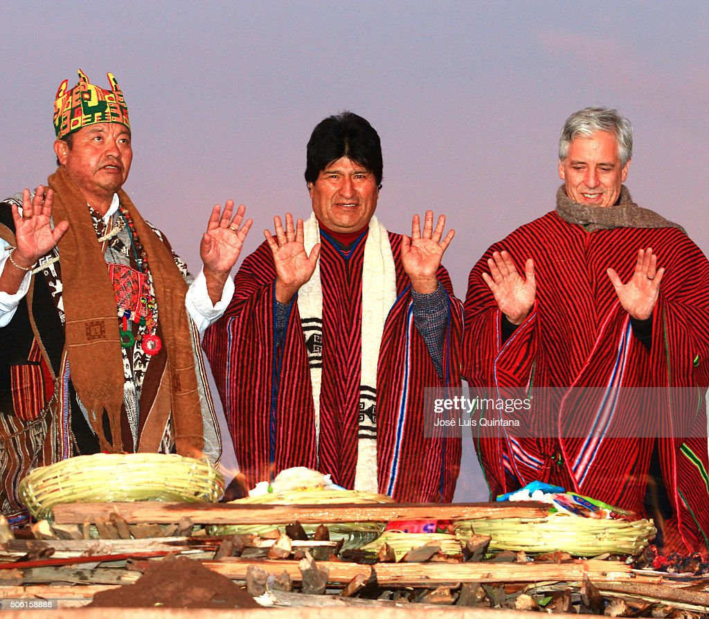 President of Bolivia (C), Vicepresident Alvaro Garcia and an aymara priest raise their hands to receive the sunlight of the dawn during the celebration of the 10th anniversary of <a gi-track='captionPersonalityLinkClicked' href=/galleries/search?phrase=Evo+Morales&family=editorial&specificpeople=272981 ng-click='$event.stopPropagation()'>Evo Morales</a>' government on January 21, 2016. Morales and members of his cabinet gave an offering to the 'Pachamama' (Mother earth) as part of the celebration of his 10th year as Bolivia President.
