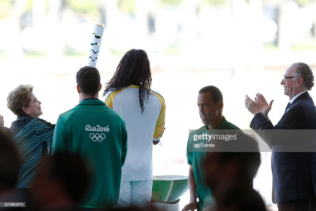 President of Brazil Dilma Rousseff (L) and President of the Brazilian Olympic Committee Carlos Nuzman (R) attend a ceremony where the pyre and the Olympic torch are lit to start the relay at the Planalto Palace on May 3, 2016 in Brasilia, Brazil. The Olympic torch will pass through 329 cities from all states in Brazil before arriving in Rio de Janeiro on August 5, for the lighting of the cauldron.