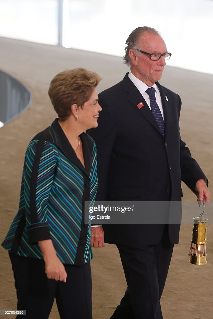 President of Brazil <a gi-track='captionPersonalityLinkClicked' href=/galleries/search?phrase=Dilma+Rousseff&family=editorial&specificpeople=1955968 ng-click='$event.stopPropagation()'>Dilma Rousseff</a> and President of the Brazilian Olympic Committee Carlos Nuzman attend a ceremony where the pyre and the Olympic torch are lit to start the relay at the Planalto Palace on May 3, 2016 in Brasilia, Brazil. The Olympic torch will pass through 329 cities from all states in Brazil before arriving in Rio de Janeiro on August 5, for the lighting of the cauldron.