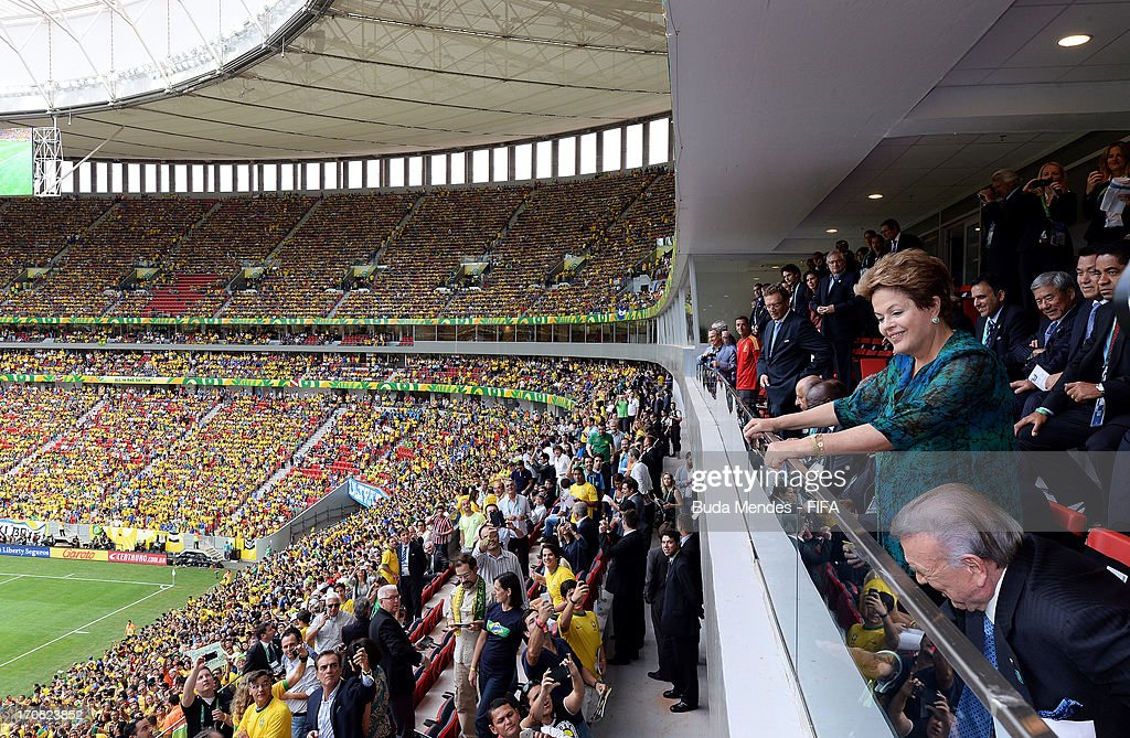 President of Brazil Dilma Rousseff waves to the crowd during the FIFA Confederations Cup Brazil 2013 Group A match between Brazil and Japan at National Stadium on June 15, 2013 in Brasilia, Brazil.