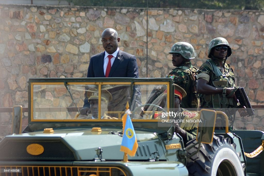President of Burundi Pierre Nkurunziza stands in a car during a ceremony to celebrate Independence Day in Bujumbura on July 1, 2016. / AFP / ONESPHORE