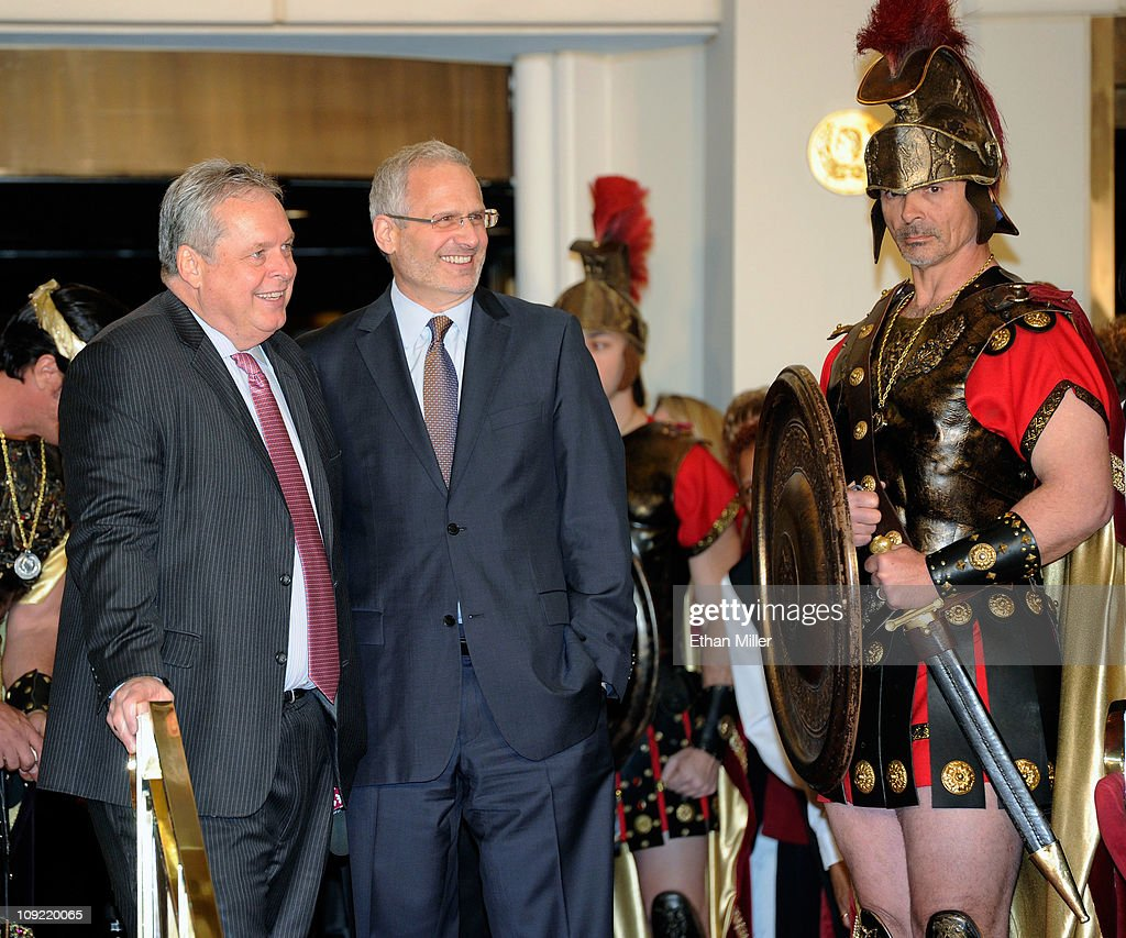 President of Caesars Entertainment Corp Western Division Tom Jenkin Caesars Palace President Gary Selesner and a Roman character wait for singer...