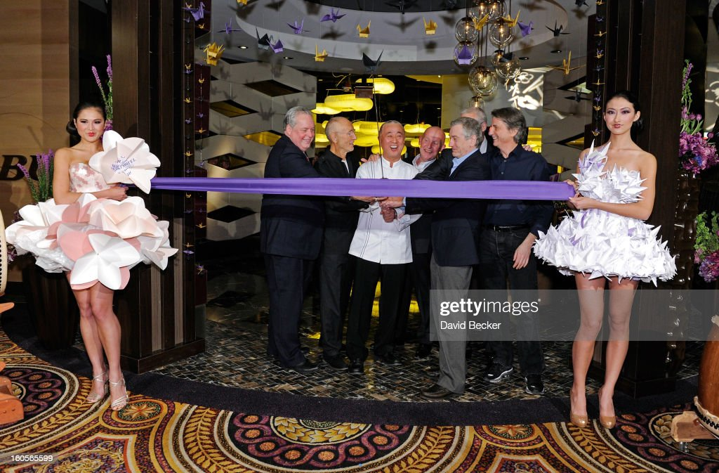 President of Caesars Entertainment Corp. Western Division Tom Jenkin, Meir Teper, chef Nobu Matsuhisa, CEO of Nobu Hospitality Trevor Horwell, actor Robert De Niro, Caesars Palace President Gary Selesner and designer David Rockwell prepare to cut a ribbon at a preview for the Nobu Restaurant and Lounge Caesars Palace on February 2, 2013 in Las Vegas, Nevada. The Nobu Hotel Restaurant and Lounge Casears Palace is scheduled to open on February 4.