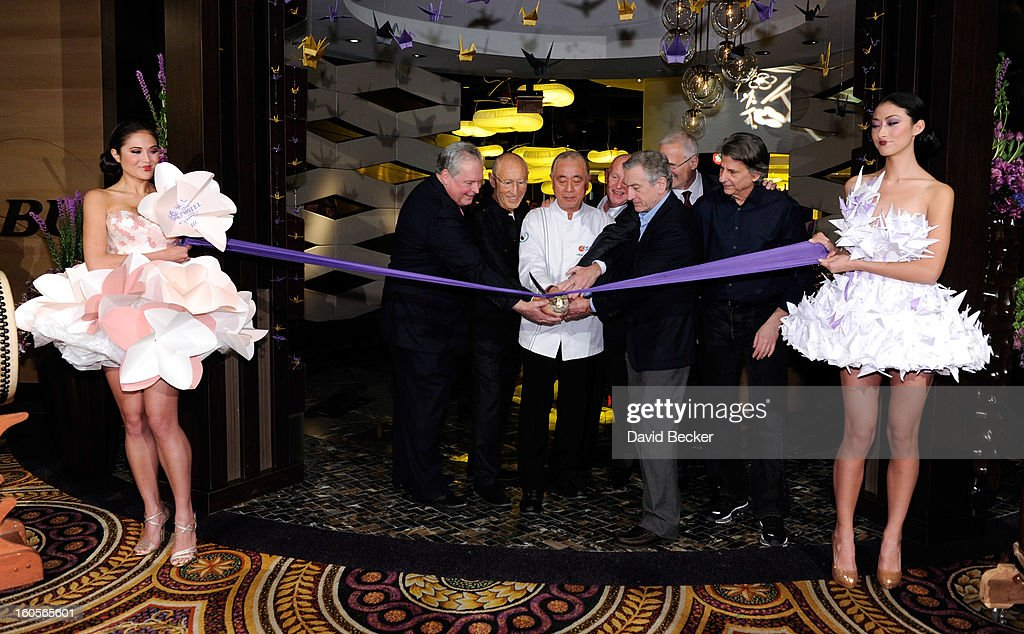 President of Caesars Entertainment Corp. Western Division Tom Jenkin, Meir Teper, chef Nobu Matsuhisa, CEO of Nobu Hospitality Trevor Horwell, actor Robert De Niro, Caesars Palace President Gary Selesner and designer David Rockwell cut a ribbon during a ceremony at a preview for the Nobu Restaurant and Lounge Caesars Palace on February 2, 2013 in Las Vegas, Nevada. The Nobu Hotel Restaurant and Lounge Casears Palace is scheduled to open on February 4.