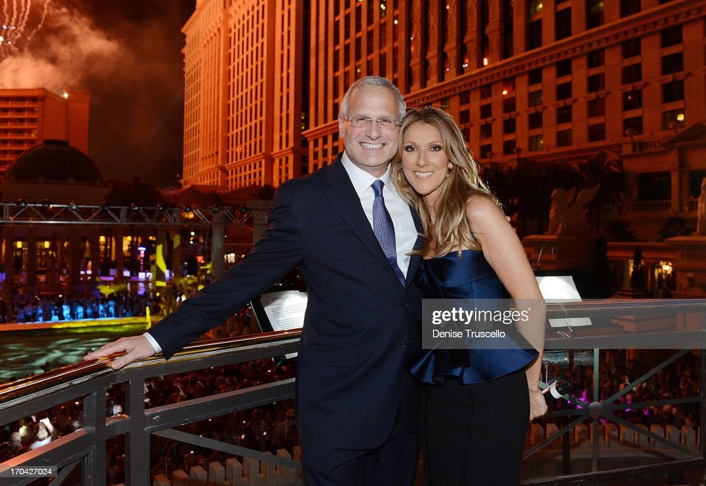 President of Caesars Palace Gary Selesner and the Colosseum at Caesars Palace headliner Celine Dion during the closing night party for IPW 2013 at the Garden for the Gods pool at Caesars Palace on June 12, 2013 in Las Vegas, Nevada.