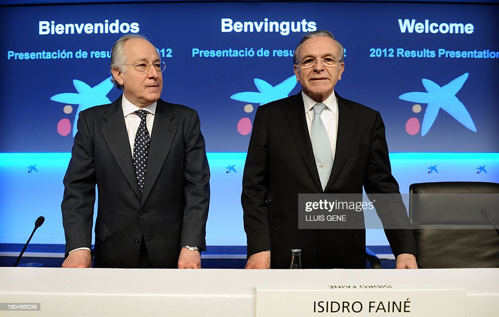 President of Caixabank Isidre Faine (R) and Chairman of Caixabank Juan Maria Nin pose prior to giving a press conference to announce the 2012 results on February 1, 2013 in Barcelona. CaixaBank, Spain's biggest bank as measured by assets under management, said today that its 2012 net profit plunged 78.2 percent to 230 million euros ($312 million) as a result of having to make greater provisions to cover potential real-estate losses.