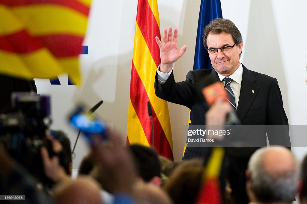 President of Catalonia and of the Pro-Independent Catalan Convergence and Unity party (CIU) <a gi-track='captionPersonalityLinkClicked' href=/galleries/search?phrase=Artur+Mas&family=editorial&specificpeople=712829 ng-click='$event.stopPropagation()'>Artur Mas</a> greets the crowd before delivering his speech after the regional elections held in Catalunya on November 25, 2012 in Barcelona, Spain. According to reports, Mas's party has failed to win a majority after millions of Catalans voted in today's Parliamentary elections. It is expected that the CIU will seek an alliance with the Esquerra party after exit polls suggested they will win 11 to 14 seats too few.