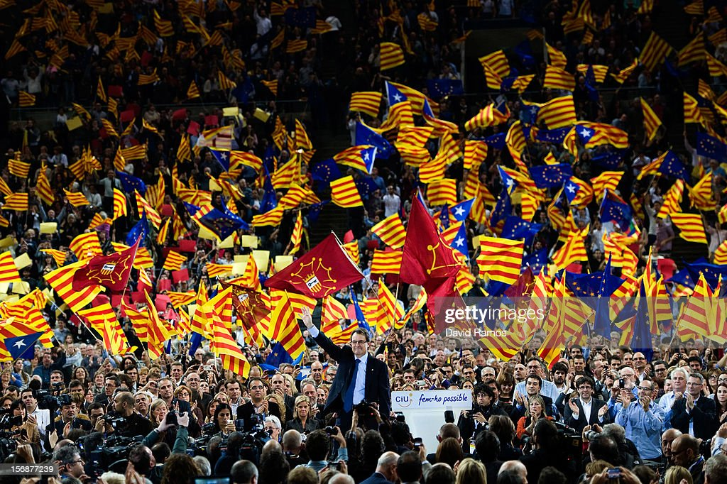 President of Catalonia and President of the Pro-independent political party Convergence and Union (CIU) <a gi-track='captionPersonalityLinkClicked' href=/galleries/search?phrase=Artur+Mas&family=editorial&specificpeople=712829 ng-click='$event.stopPropagation()'>Artur Mas</a> waves to supporters during the closing rally ahead of the Catalan Elections, at the Palau Sant Jordi on November 23, 2012 in Barcelona, Spain. Over five million Catalans will be voting in Parliamentary elections on November 25, with opinion polls showing majority support for pro-independence parties.