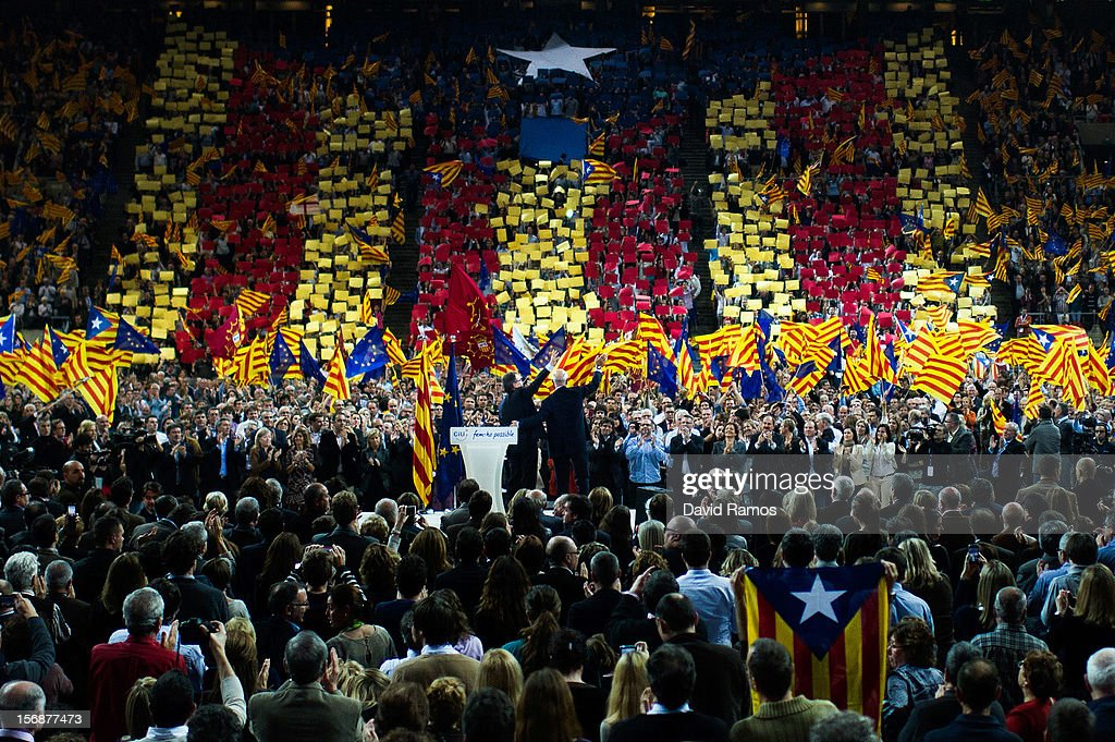 President of Catalonia and President of the Pro-independent political party Convergence and Union (CIU) Artur Mas (L) and Josep Antoni Duran i LLeida, President of Democratic Union of Catalonia, a political party which is part of Convergence and Union (CIU), wave to supporters during the closing rally ahead of Catalan Elections at the Palau Sant Jordi on November 23, 2012 in Barcelona, Spain. Over five million Catalans will be voting in Parliamentary elections on November 25, with opinion polls showing majority support for pro-independence parties.