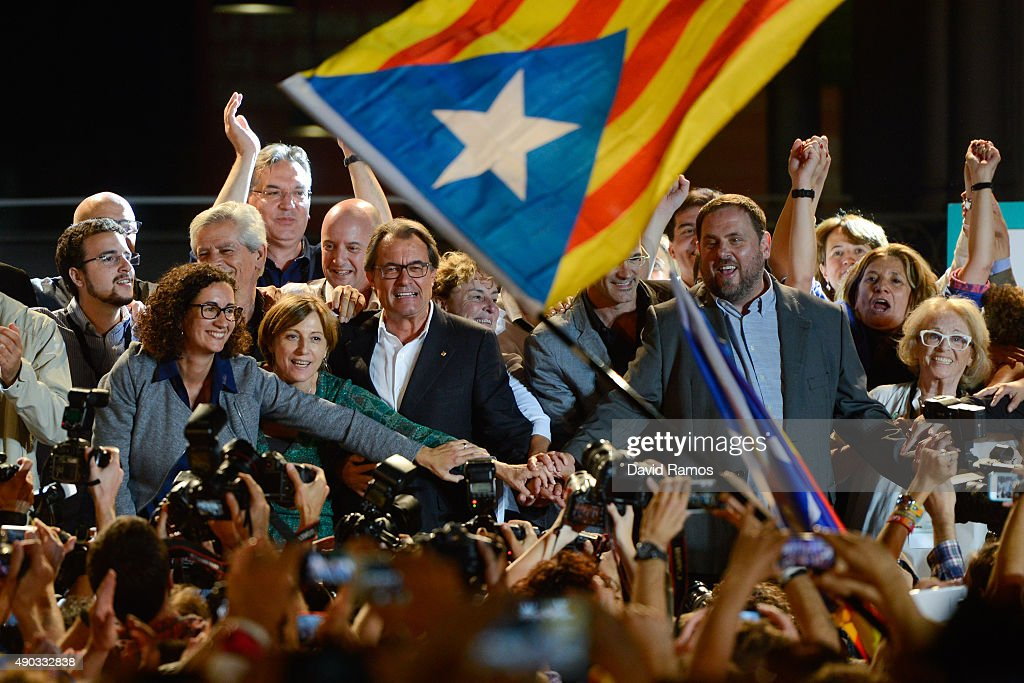 President of Catalonia Artur Mas (C) and President of Catalonia 'Esquerra Republicana de Catalunya' party (ERC) Oriol Junqueras (R) celebrate after the Catalanist coalition 'Junts Pel Si' (Together for the Yes) claimed victory in the regional elections held in Catalonia on September 27, 2015 in Barcelona, Spain. The main Catalanist parties, Catalan Democratic Convergence 'Convergencia Democratica de Catalunya' party (CDC), Republican Leftist of Catalonia 'Esquerra Republicana de Catalunya' party (ERC) and a group of social associations have joined together to form a Catalan pro-independence coalition 'Junts pel Si' (Together for the Yes). Over 5 million Catalans are called to vote in Parliamentary elections on September 27, with opinion polls predicting that the majority of seats will be won by pro-independence parties, which could lead to a push for independence in Catalonia.