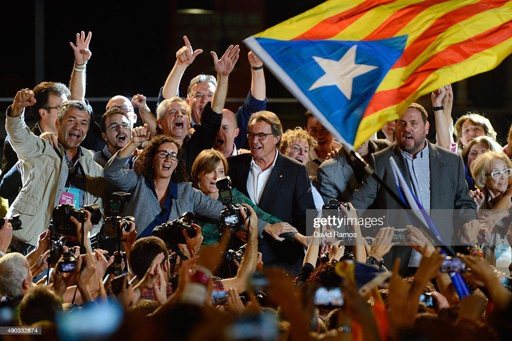 President of Catalonia Artur Mas and President of Catalonia 'Esquerra Republicana de Catalunya' party Oriol Junqueras celebrate after the Catalanist...