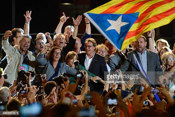 President of Catalonia Artur Mas and President of Catalonia 'Esquerra Republicana de Catalunya' party Oriol Junqueras celebrate after the Catalanist...