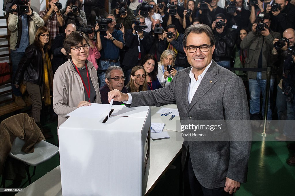 President of Catalonia <a gi-track='captionPersonalityLinkClicked' href=/galleries/search?phrase=Artur+Mas&family=editorial&specificpeople=712829 ng-click='$event.stopPropagation()'>Artur Mas</a> casts his vote at a polling station on November 9, 2014 in Barcelona, Spain. Catalans vote today during an unofficial and non-binding consultation on independence of Catalonia from Spain. The decision of the Spain's Constitutional Court to suspend the act has not dissuaded the pro-independence movement from going ahead with the polling and a high turnout is expected.