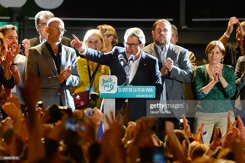 President of Catalonia Artur Mas celebrates as he speaks to wellwishers after the Catalanist coalition 'Junts Pel Si' reportedly won exit polls in...
