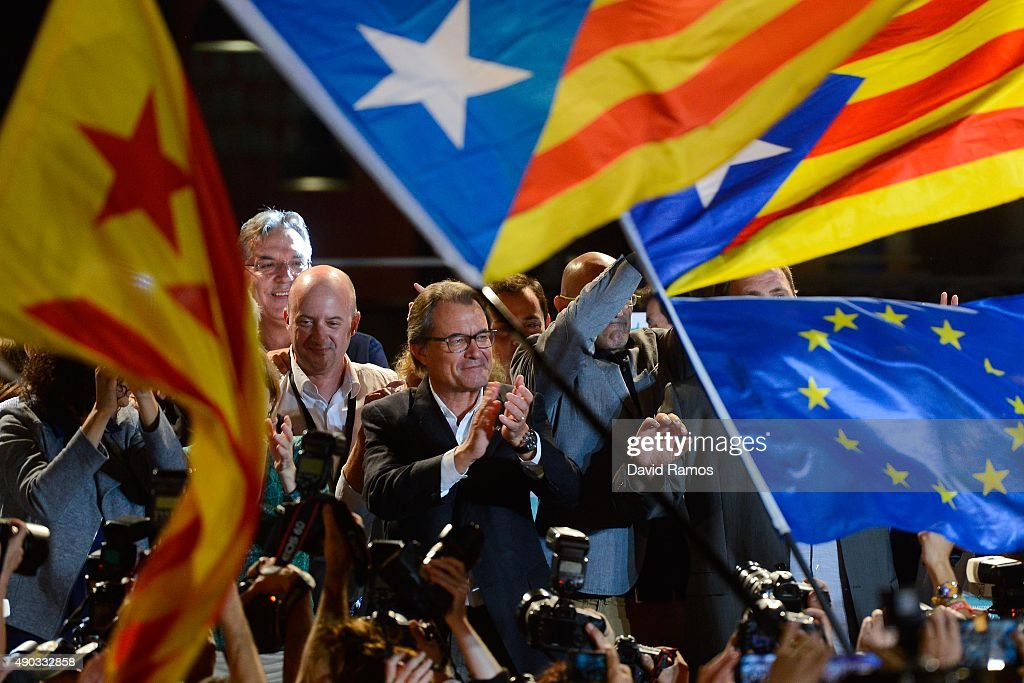 President of Catalonia Artur Mas (C) celebrates as the Catalanist coalition 'Junts Pel Si' (Together for the Yes) claim victory in the regional elections held in Catalonia on September 27, 2015 in Barcelona, Spain. The main Catalanist parties, Catalan Democratic Convergence 'Convergencia Democratica de Catalunya' party (CDC), Republican Leftist of Catalonia 'Esquerra Republicana de Catalunya' party (ERC) and a group of social associations have joined together to form a Catalan pro-independence coalition 'Junts pel Si' (Together for the Yes). Over 5 million Catalans are called to vote in Parliamentary elections on September 27, with opinion polls predicting that the majority of seats will be won by pro-independence parties, which could lead to a push for independence in Catalonia.
