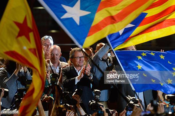 President of Catalonia Artur Mas celebrates as the Catalanist coalition 'Junts Pel Si' claim victory in the regional elections held in Catalonia on...