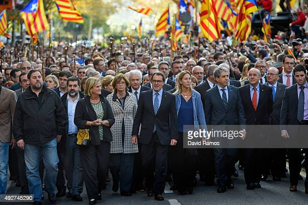 President of Catalonia Artur Mas surrounded by Catalonia Government members deputies of the Parliament of Catalonia mayors and representatives from...