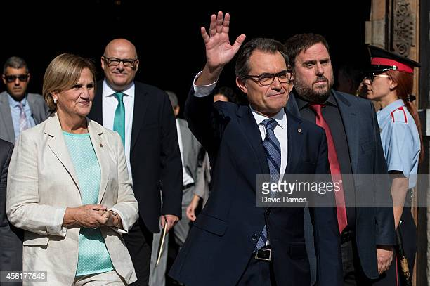President of Catalonia Artur Mas waves as he leaves the Palau de la Generalitat the Catalan government building next to President of the Parliament...