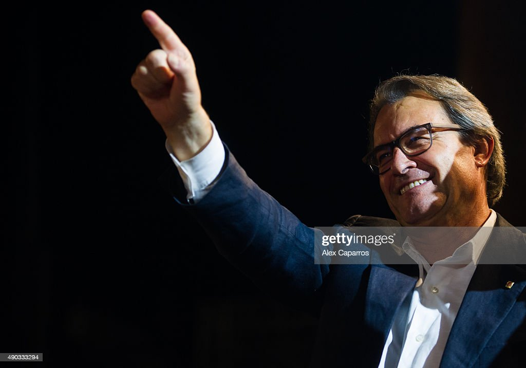 President of Catalonia Artur Mas waves to wellwishers after the Catalanist coalition 'Junts pel Si' (Together for the Yes) won the regional elections held in Catalonia on September 27, 2015 in Barcelona, Spain. The main Catalanist parties, Catalan Democratic Convergence 'Convergencia Democratica de Catalunya' party (CDC), Republican Leftist of Catalonia 'Esquerra Republicana de Catalunya' party (ERC) and a group of social associations have joined together to form a Catalan pro-independence coalition 'Junts pel Si' (Together for the Yes). Over 5 million Catalans are called to vote in Parliamentary elections on September 27, with opinion polls predicting that the majority of seats will be won by pro-independence parties, which could lead to a push for independence in Catalonia.