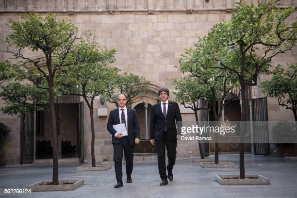 President of Catalonia Carles Puigdemont and Jordi Turull Catalonia's government spokesman arrive at a government meeting at the Palau de la...