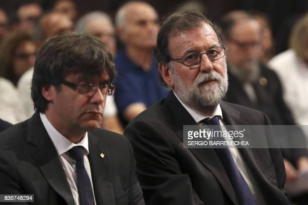 President of Catalonia Carles Puigdemont and Spanish Prime Minister Mariano Rajoy attend a mass to commemorate victims of two devastating terror...