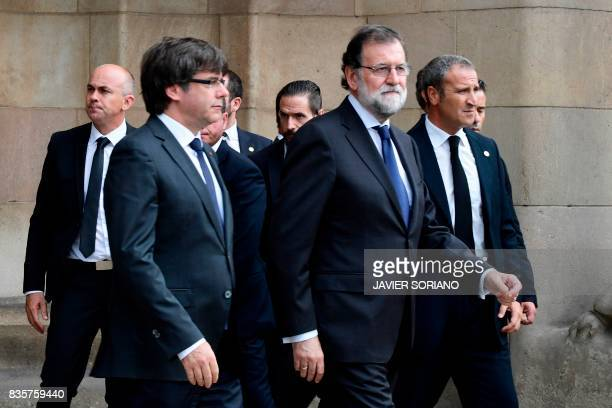 President of Catalonia Carles Puigdemont and Spanish Prime Minister Mariano Rajoy leave after a mass to commemorate victims of two devastating terror...
