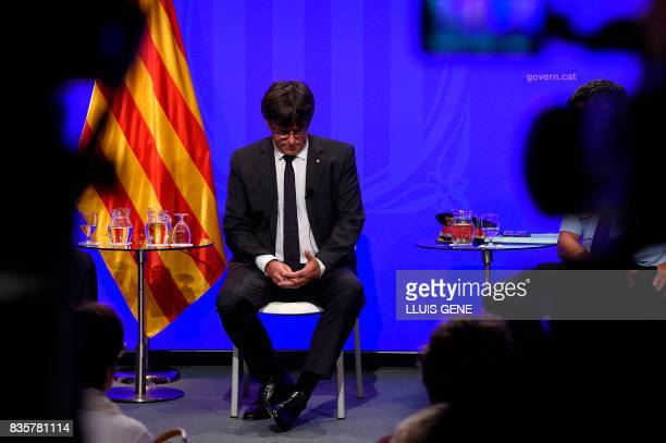President of Catalonia Carles Puigdemont looks down during a press conference at the Generalitat in Barcelona on August 20 2017 Police said they had...