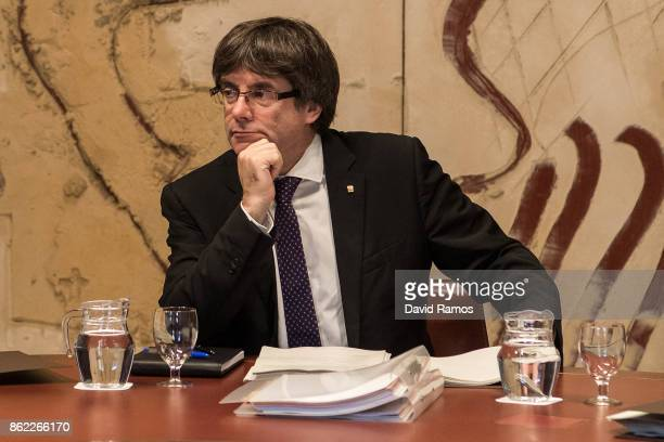 President of Catalonia Carles Puigdemont looks on during a government meeting at the Palau de la Generalitat building on October 17 2017 in Barcelona...