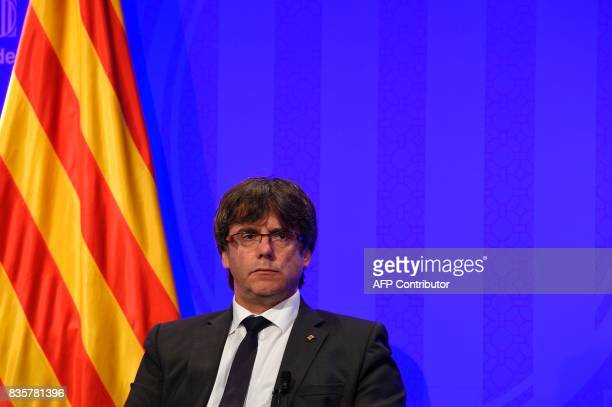 President of Catalonia Carles Puigdemont looks on during a press conference at the Generalitat in Barcelona on August 20 2017 Police said they had...