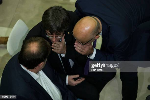 President of Catalonia Carles Puigdemont talking with Oriol Junqueras and Raul Romeva during the signs the proposal for declaration of independence...