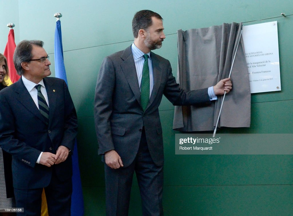 President of Catalunya <a gi-track='captionPersonalityLinkClicked' href=/galleries/search?phrase=Artur+Mas&family=editorial&specificpeople=712829 ng-click='$event.stopPropagation()'>Artur Mas</a> and Prince Felipe of Spain unveil a commemorative plaque at the Figueres-Vilafant train station for the inauguration of the AVE high-speed train line between Barcelona and the French border on January 8, 2013 in Barcelona, Spain.