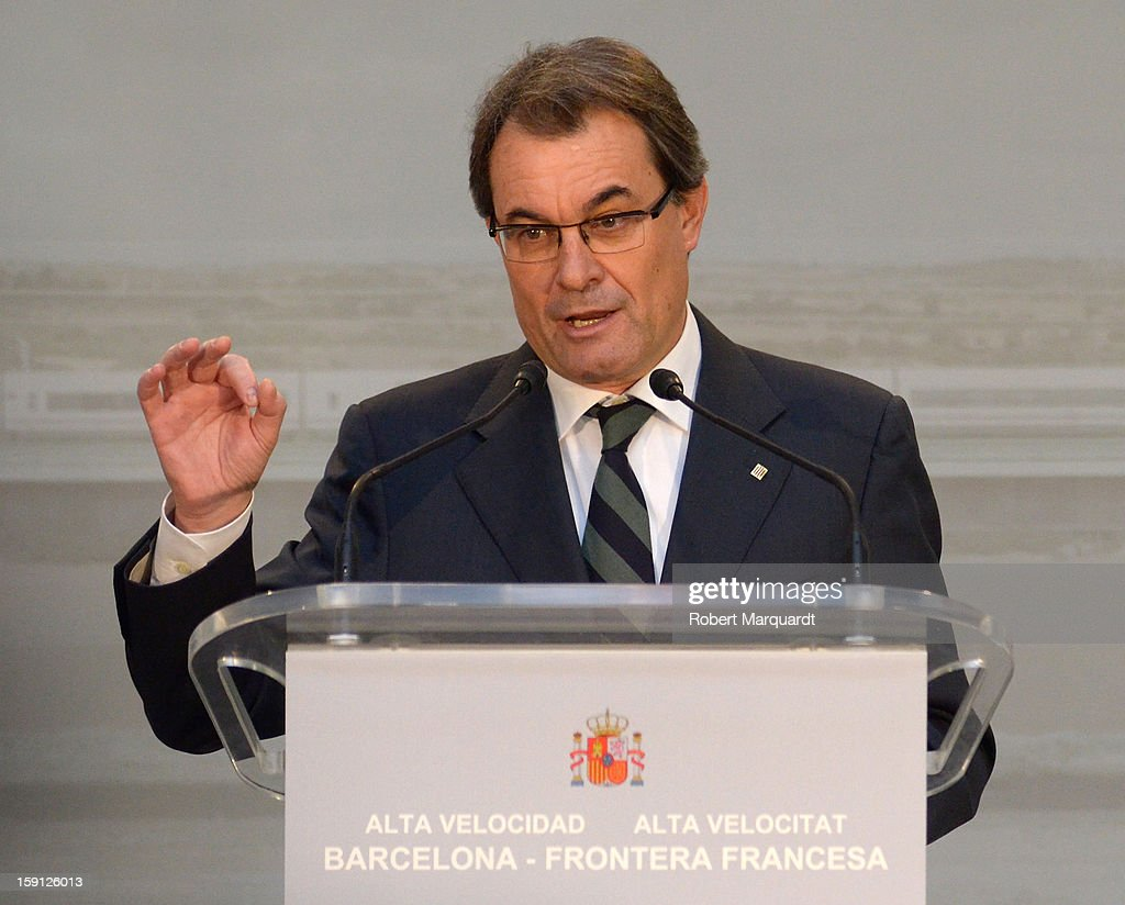President of Catalunya <a gi-track='captionPersonalityLinkClicked' href=/galleries/search?phrase=Artur+Mas&family=editorial&specificpeople=712829 ng-click='$event.stopPropagation()'>Artur Mas</a> attends a press presentation at the Girona train station for the inauguration of the AVE high-speed train line between Barcelona and the French border on January 8, 2013 in Barcelona, Spain.